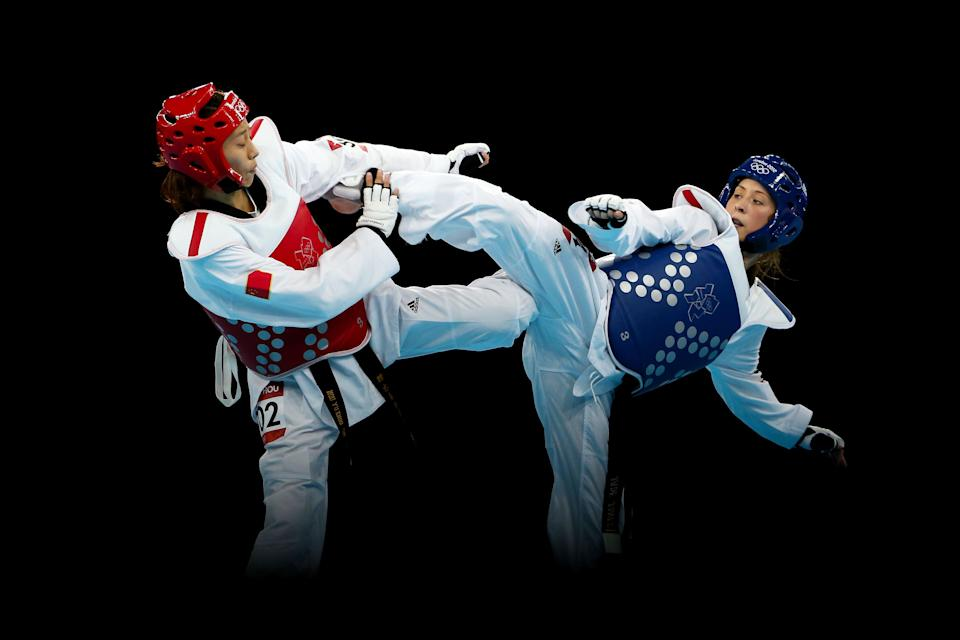 LONDON, ENGLAND - AUGUST 09: Jade Jones (R) of Great Britain competes against Yuzhuo Hou (L) of China during the Women's -57kg Taekwondo gold medal final on Day 13 of the London 2012 Olympic Games at ExCeL on August 9, 2012 in London, England. (Photo by Hannah Johnston/Getty Images)
