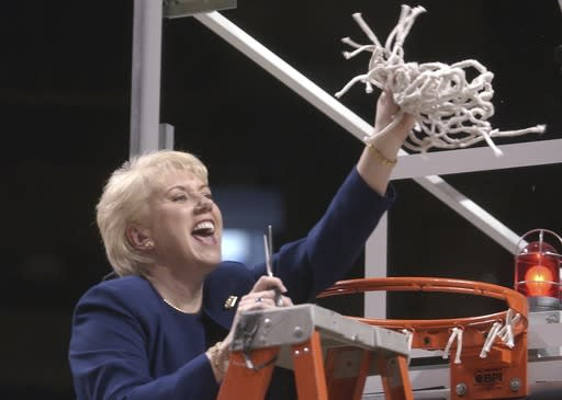 FILE - In this March 2, 2003 file photo Penn State women's basketball coach Rene Portland waves the net she cut down to celebrate their Big 10 regular season championship after defeating Wisconsin in State College, Pa. Portland, who built Penn State into a women's basketball powerhouse during a 27-year tenure, has died after a three-year fight with cancer. She was 65. D'Anjolell Memorial Home of Broomall in Pennsylvania confirmed her death Sunday, July 22, 2018. (AP Photo/Pat Little, file)