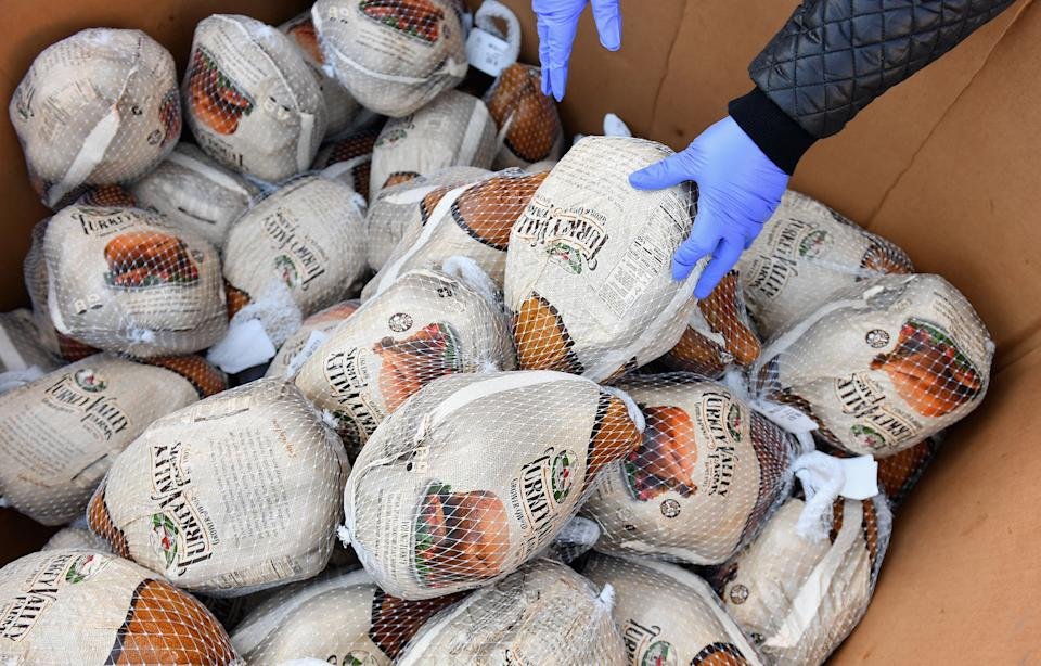 This year,food banks are relying heavily on donations and volunteers to feed their neighbors, on Thanksgiving and beyond. (Photo by ANGELA WEISS/AFP via Getty Images)