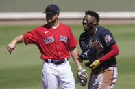 Boston Red Sox's Christian Arroyo, left, laughs with Atlanta Braves' Ronald Acuna Jr., right, in the first inning during a spring training baseball game on Monday, March 1, 2021, in Fort Myers, Fla. (AP Photo/Brynn Anderson)