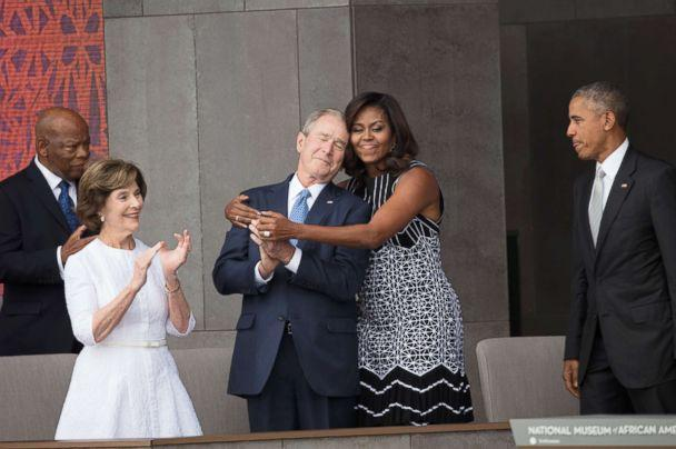 PHOTO: First Lady Michelle Obama hugs former President George W Bush at the opening of the National Museum of African American History and Culture in Washington, Sept. 24, 2016. (David Hume Kennerly/Getty Images)