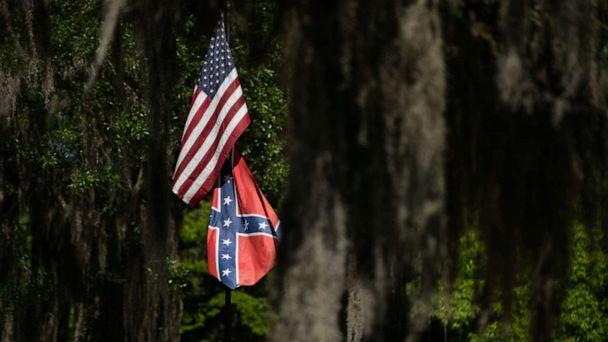 PHOTO: American and Confederate flags fly at a residence, May 7, 2020, in Brunswick, Georgia. (Sean Rayford/Getty Images)