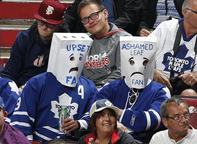 SUNRISE, FL - APRIL 10: Two Toronto Maple Leafs fans wearing paper bags over their heads watch third period action against the Florida Panthers at the BB&T Center on April 10, 2014 in Sunrise, Florida. The Panthers defeated the Maple Leafs 4-2. (Photo by Joel Auerbach/Getty Images)