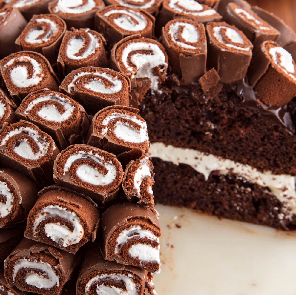 """<p>Is it the <a href=""""https://www.delish.com/uk/cooking/recipes/g30977937/chocolate-cake-recipes/"""" rel=""""nofollow noopener"""" target=""""_blank"""" data-ylk=""""slk:chocolate cake"""" class=""""link rapid-noclick-resp"""">chocolate cake</a>, the marshmallow filling, the ganache, or the insane layer of Swiss Rolls that's making you go insane right now?</p><p>Get the <a href=""""https://www.delish.com/uk/cooking/recipes/a33631617/swiss-roll-cake-recipe/"""" rel=""""nofollow noopener"""" target=""""_blank"""" data-ylk=""""slk:Swiss Roll Cake"""" class=""""link rapid-noclick-resp"""">Swiss Roll Cake</a> recipe.</p>"""