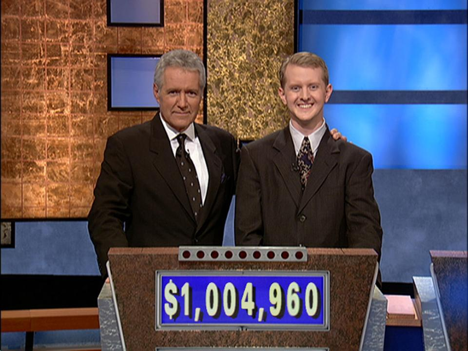 Alex Trebek poses with contestant Ken Jennings after he earned more than $1 million in 2004. (Photo: Jeopardy Productions via Getty Images)