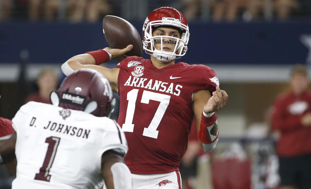 Arkansas quarterback Nick Starkel (17) throws as Texas A&M linebacker Buddy Johnson (1) closes in during the first half of an NCAA college football game Saturday, Sept. 28, 2019, in Arlington, Texas. (AP Photo/Ron Jenkins)