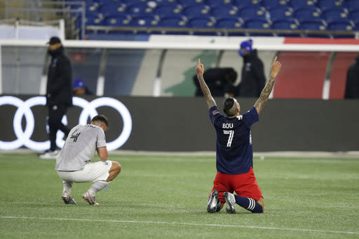 New England Revolution forward Gustavo Bou (7) celebrates as the final whistle blows, next to Montreal Impact defender Rudy Camacho in an MLS soccer match, Friday, Nov. 20, 2020, in Foxborough, Mass. The Revolution won 2-1. (AP Photo/Stew Milne)