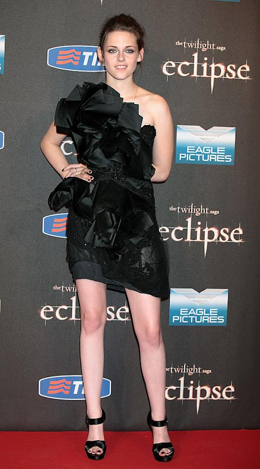"Despite her awkward pose, Kristen Stewart stole the spotlight in Rome at the Italian premiere of ""Eclipse"" thanks to her Marchesa masterpiece, which featured one-shoulder detailing and sculpted satin ruffles. Roger Vivier heels completed her luxurious look. Elisabetta A. Villa/<a href=""http://www.wireimage.com"" target=""new"">WireImage.com</a> - June 17, 2010"