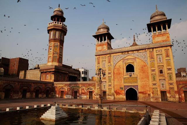 <b>LAHORE, PAKISTAN: </b>Pigeons fly over the Wazir Khan Mosque in the walled city of Old Lahore in Pakistan. The great mosque was built by built by Hakim Shaikh Ilm-ud-din Ansari, court physician to the Mughal emperor Shah Jahan who later rose to the status of governor. Construction began around 1634–1635 and lasted seven years.