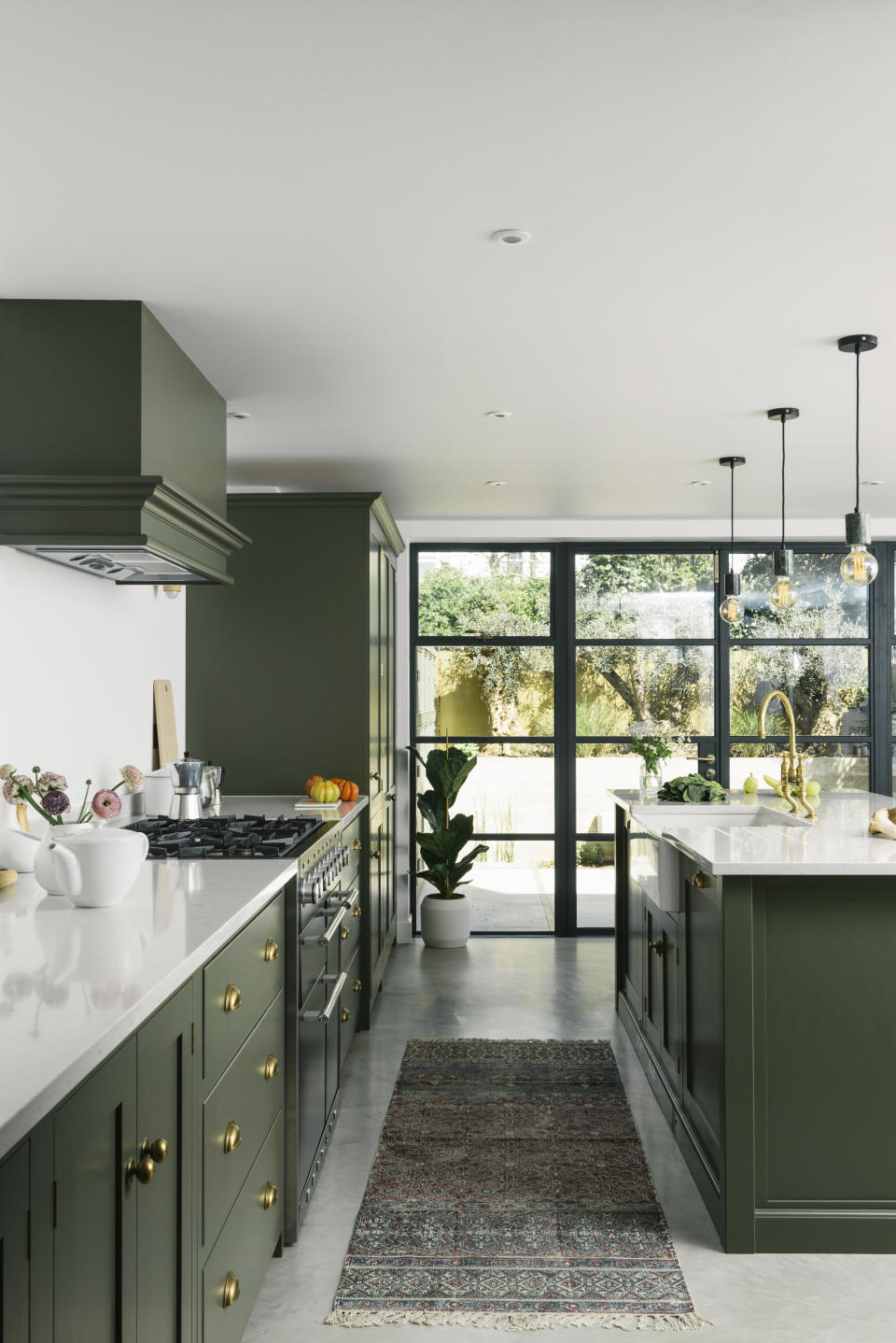 Green light shaker kitchen with Crittal-style windows