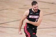 Miami Heat guard Goran Dragic (7) celebrate scoring against the Boston Celtics during the second half of Game 4 of an NBA basketball Eastern Conference final, Wednesday, Sept. 23, 2020, in Lake Buena Vista, Fla. (AP Photo/Mark J. Terrill)