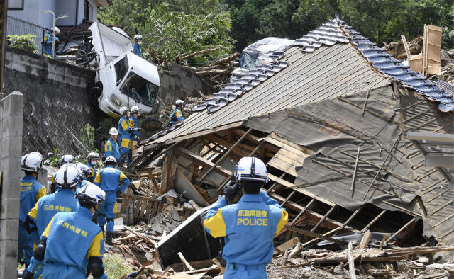 <p>Rescuers prepare to start a search mission for missing person at the site of a landslide in Kumano town, Hiroshima prefecture, western Japan, July 9, 2018. (Photo: Sadayuki Goto/Kyodo News via AP) </p>
