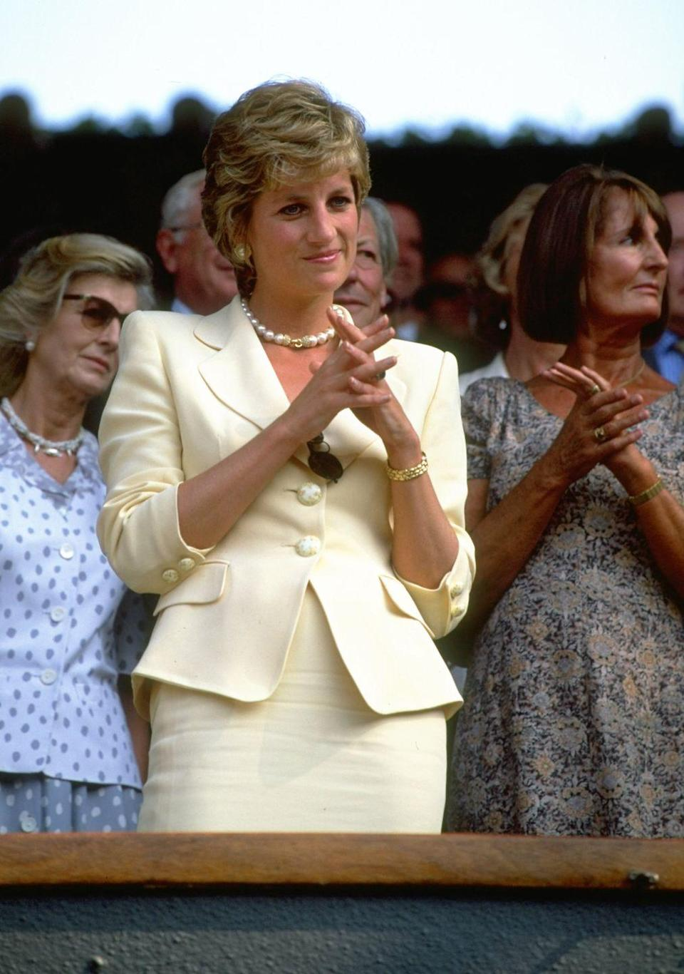 <p><strong>1995</strong> Princess Diana wore a pastel lemon skirt suit, which she accessorised with chunky pearl jewellery for the men's final in 1995.</p>