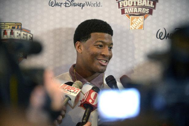 Florida State quarterback Jameis Winston, center, answers questions during a media availability prior to the College Football Awards show in Lake Buena Vista, Fla., Wednesday, Dec. 11, 2013. (AP Photo/Phelan M. Ebenhack)