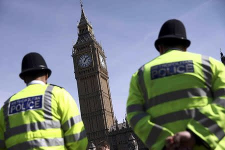 Police officers patrol in Parliament Square following the attack in Westminster earlier in the week, in central London
