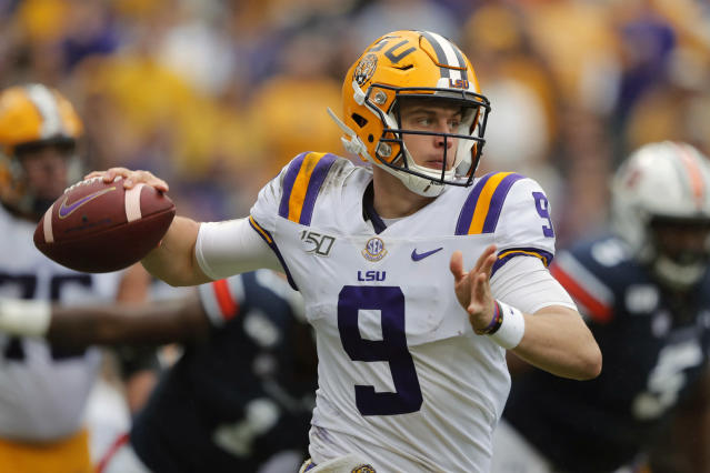 FILE - In this Oct. 26, 2019, file photo, LSU quarterback Joe Burrow (9) scrambles in the first half of an NCAA college football game against the Auburn, in Baton Rouge, La. For the first time in college football history, there will be two games matching teams of at least 8-0 on the same day, according to ESPN Facts and Info. In Tuscaloosa, Alabama, LSU and the Crimson Tide will play the first regular-season game matching AP Nos. 1 and 2 since 2011 _ when No. 1 LSU beat No. 2 Alabama 9-6 in overtime. (AP Photo/Gerald Herbert, File)