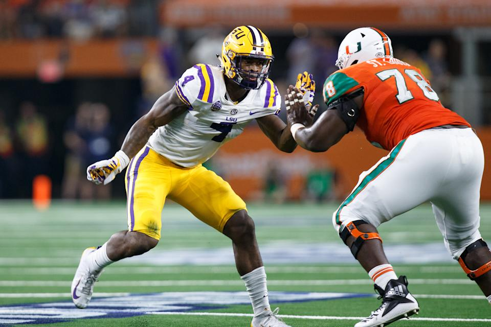 LSU linebacker K'Lavon Chaisson, left, is coming off an ACL injury but has elite traits and talent. (Getty Images).