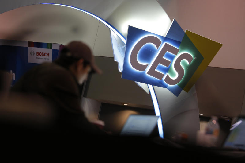 A worker helps set up a booth before CES International, Saturday, Jan. 4, 2020, in Las Vegas. (AP Photo/John Locher)