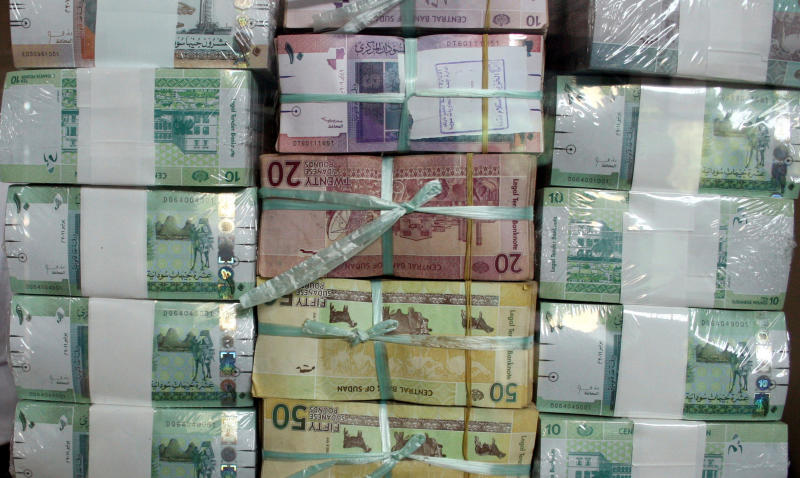 Sudan's new currency sits behind a window at the central bank in Khartoum, Sudan, Sunday July 24, 2011. The Sudanese government began circulating the new Sudanese pound bank-notes on Sunday as a precautionary measure following the loss of oil revenues resulting from South Sudan's independence, according to Sudan's President Omar al-Bashir.  South Sudan became officially independent from the north on July 9, breaking away after more than 50-years of on-and-off war. (AP Photo/Abd Raouf)