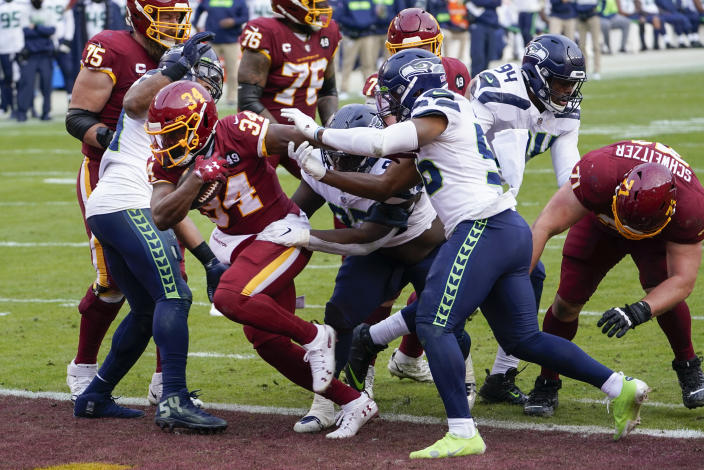 Washington Football Team running back Peyton Barber (34) runs past the Seattle Seahawks defense to score a touchdown during the second half of an NFL football game, Sunday, Dec. 20, 2020, in Landover, Md. (AP Photo/Susan Walsh)