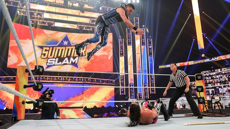 Dominik Mysterio using his signature frog splash during his match against Seth Rollins at SummerSlam. (Photo credit: WWE)