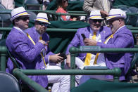 Men talk as they watch a race before the 147th running of the Kentucky Derby at Churchill Downs, Saturday, May 1, 2021, in Louisville, Ky. (AP Photo/Michael Conroy)