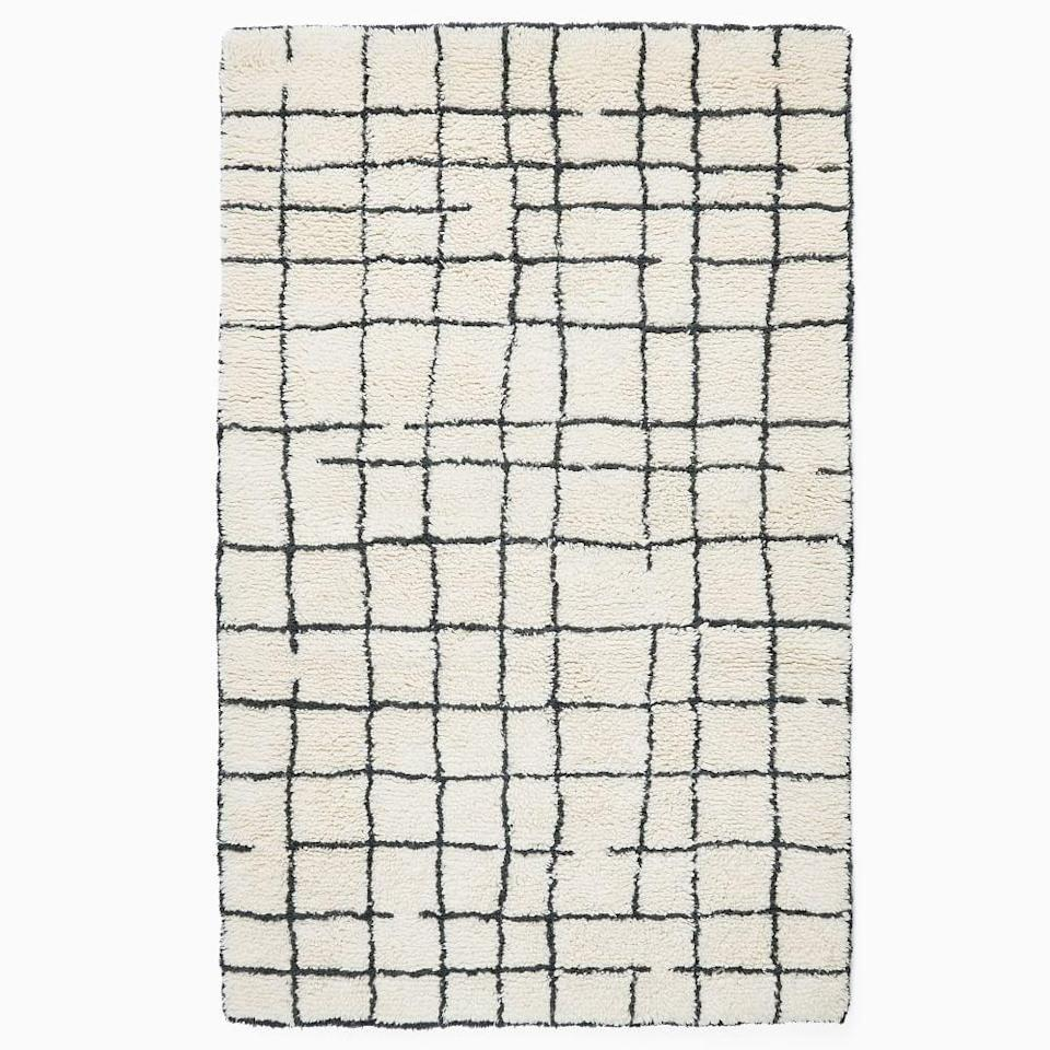 <p>We're all about trendy pattern rugs right now, and the <span>West Elm Grid Shag Rug</span> ($360, originally $900) is our current favorite. It comes in several sizes, but we have our eye on the eight by ten choice, because that's a great price for a large area rug.</p>