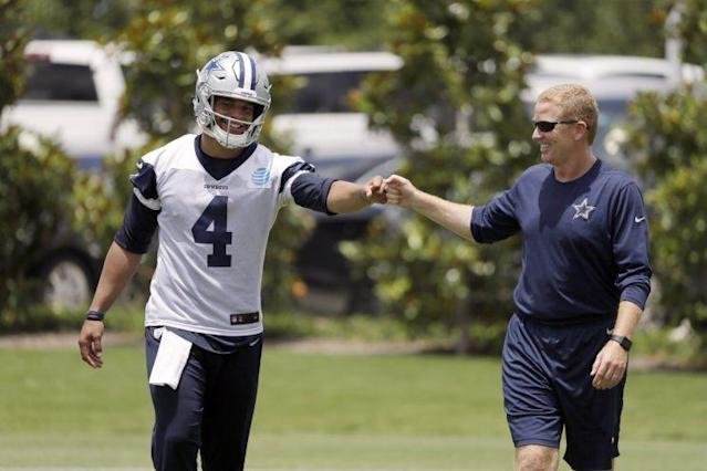 Dak Prescott and head coach Jason Garrett appear to be on good terms at minicamp this week. (AP)