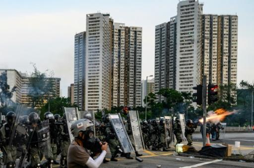 Hong Kong police fire tear gas at protesters in Tai Po district, one of at least 11 locations where they battled to disperse protesters in the most widespread unrest during two months of demonstrations