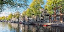 """<p>It's hard to top <a href=""""https://www.bestproducts.com/fun-things-to-do/a1643/best-things-to-do-in-amsterdam/"""" rel=""""nofollow noopener"""" target=""""_blank"""" data-ylk=""""slk:Amsterdam"""" class=""""link rapid-noclick-resp"""">Amsterdam</a> when it comes to lovely cityscapes, especially due to its historic canals, including Prinsengracht and Keizergracht, which are lined with 18th-century gabled buildings.</p><p>The many cyclists who cross their stone bridges also cut a pretty picture. Plus, the major canals are just a few minutes' walk to must-visit museums, like the <a href=""""https://www.tripadvisor.com/Attraction_Review-g188590-d190554-Reviews-Van_Gogh_Museum-Amsterdam_North_Holland_Province.html"""" rel=""""nofollow noopener"""" target=""""_blank"""" data-ylk=""""slk:Van Gogh Museum"""" class=""""link rapid-noclick-resp"""">Van Gogh Museum</a> and the <a href=""""https://www.tripadvisor.com/Attraction_Review-g188590-d189379-Reviews-Rijksmuseum-Amsterdam_North_Holland_Province.html"""" rel=""""nofollow noopener"""" target=""""_blank"""" data-ylk=""""slk:Rijksmuseum"""" class=""""link rapid-noclick-resp"""">Rijksmuseum</a>.</p>"""