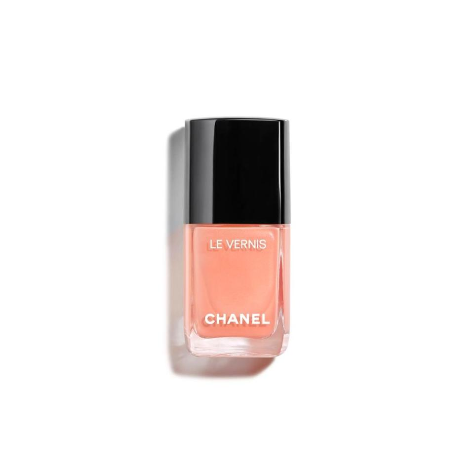 """<h3>Chanel 560 Coquillage <br></h3><br>This peach with a hint of golden iridescence is the chicest way to bring a <a href=""""https://www.refinery29.com/en-us/pastel-nail-polish-colors"""" rel=""""nofollow noopener"""" target=""""_blank"""" data-ylk=""""slk:pastel tone"""" class=""""link rapid-noclick-resp"""">pastel tone</a> into the fall season.<br><br><strong>Chanel</strong> LE VERNIS Longwear Nail Colour, $, available at <a href=""""https://go.skimresources.com/?id=30283X879131&url=https%3A%2F%2Fwww.chanel.com%2Fus%2Fmakeup%2Fp%2F159745%2Fle-vernis-longwear-nail-colour%2F%3Fgclid%3DEAIaIQobChMIxYzsuMDw6wIVErbICh3PfAZHEAQYAyABEgIYNfD_BwE"""" rel=""""nofollow noopener"""" target=""""_blank"""" data-ylk=""""slk:Chanel"""" class=""""link rapid-noclick-resp"""">Chanel</a>"""