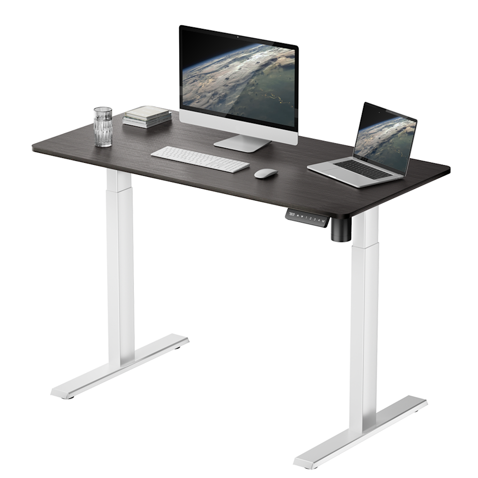 """<h2>Best Standing Desk Under $150<br></h2><br><h3>Farmree Best Standing Desk</h3><br><strong>The Hype</strong>: 4.1 out of 5 stars and 14 reviews on <a href=""""https://www.google.com/shopping/product/1037353601356651249/reviews"""" rel=""""nofollow noopener"""" target=""""_blank"""" data-ylk=""""slk:Google"""" class=""""link rapid-noclick-resp"""">Google</a><br><br><strong>WFH Heroes Say:</strong> """"First thought when taking it out of the box was that the colors are really sharp. The dark top and clean white legs are a really nice look. I personally needed something smaller to fit in my apartment and this was a perfect size. Putting it together was fairly easy...I use it to hold my laptop, a pen cup, a few notebooks, and a small coaster for my drink. I've been using it for about a week now and I am overall very happy. I love being able to stand up and stretch without having to bend back over to look at my screen!"""" <br><br><em>Shop</em> <strong><em><a href=""""https://www.walmart.com/tp/famree"""" rel=""""nofollow noopener"""" target=""""_blank"""" data-ylk=""""slk:Farmree"""" class=""""link rapid-noclick-resp"""">Farmree</a></em></strong><br><br><strong>Famree</strong> Electric Standing Desk, $, available at <a href=""""https://go.skimresources.com/?id=30283X879131&url=https%3A%2F%2Fwww.walmart.com%2Fip%2FFamree-Electric-Standing-Desk-for-Home-Office-Sit-to-Stand-Height-Adjustable-Computer-Workstation-with-Memory-Preset-Controller%2F805200974"""" rel=""""nofollow noopener"""" target=""""_blank"""" data-ylk=""""slk:Walmart"""" class=""""link rapid-noclick-resp"""">Walmart</a>"""