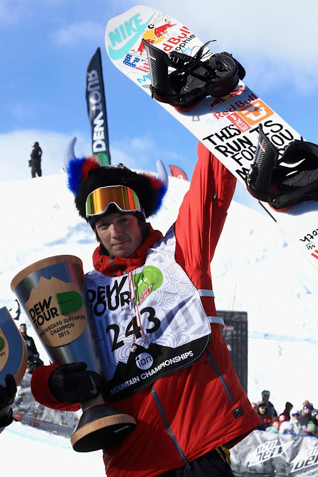 BRECKENRIDGE, CO - DECEMBER 14: Greg Bretz celebrates on the podium after winning the men's snowboard superpipe final at the Dew Tour iON Mountain Championships on December 14, 2013 in Breckenridge, Colorado. (Photo by Doug Pensinger/Getty Images)