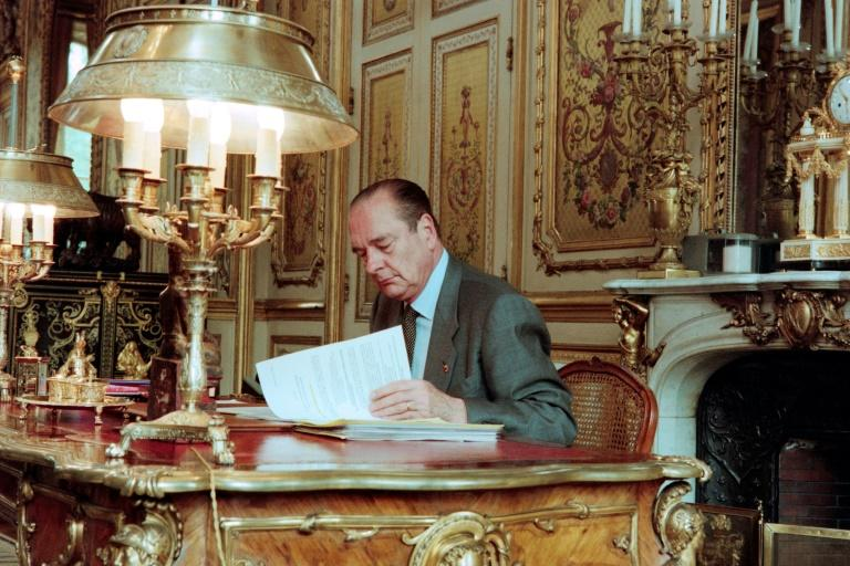 French President Jacques Chirac poses at his desk at the Elysee Palace in Paris in April 1996