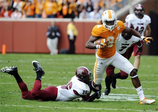 Tennessee wide receiver Cordarrelle Patterson (84) carries the ball as Troy defensive back Bryan Willis (26) tries to stop him during their NCAA college football game, Saturday, Nov. 3, 2012, in Knoxville, Tenn. (AP Photo/Knoxville News Sentinel, Amy Smotherman Burgess)