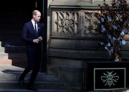 Britain's Prince William leaves a tribute message as he leaves a memorial service on the first anniversary of the Manchester Arena bombing, in Manchester, Britain, May 22, 2018. REUTERS/Darren Staples