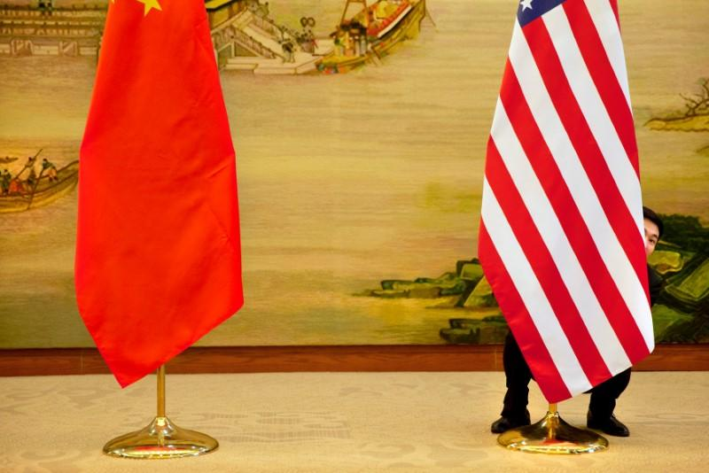 FILE PHOTO: U.S. flag is tweaked ahead of a news conference between U.S. Secretary of State John Kerry and Chinese Foreign Minister Wang Yi at the Ministry of Foreign Affairs in Beijing