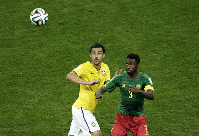 Brazil's Fred fights for the ball with Cameroon's Nicolas N'Koulou during the group A World Cup soccer match between Cameroon and Brazil at the Estadio Nacional in Brasilia, Brazil, Monday, June 23, 2014. (AP Photo/Christophe Ena)