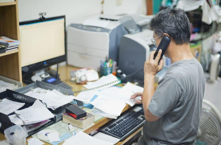 Single man uses computer for work in small office