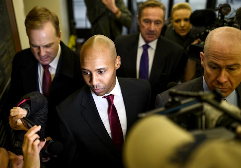 Image: Former Minneapolis Police officer Mohamed Noor arrives with his lawyers for the beginning of his trial on April 1, 2019 in Minneapolis. (Stephen Maturen / Getty Images file)