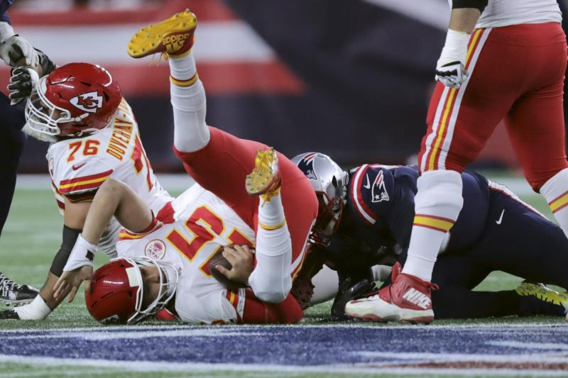 Patrick Mahomes lands on the turf after he was sacked by New England Patriots defensive tackle Adam Butler.