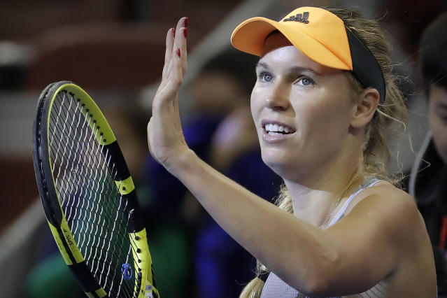 FILE - In this Friday, Oct. 4, 2019 file photo, Caroline Wozniacki of Denmark reacts after beating Daria Kasatkina of Russia in their quarterfinal match in the China Open tennis tournament in Beijing. Wozniacki has announced on Friday, Dec. 6, 2019 she will retire after the Australian Open. (AP Photo/Mark Schiefelbein, file)
