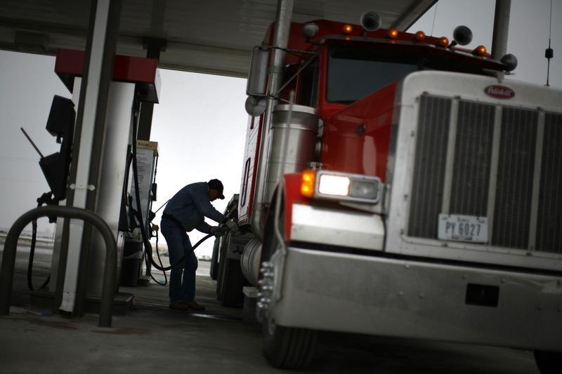 File Photo: Truck driver Randy Walker fills his rig with biodiesel fuel in Nevada, Iowa