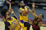 Los Angeles Lakers' LeBron James drives to the basket against Cleveland Cavaliers' Isaac Okoro, right, in the second half of an NBA basketball game, Monday, Jan. 25, 2021, in Cleveland. Jarrett Allen, left, and Anthony Davis watch. The Lakers own 115-108. (AP Photo/Tony Dejak)