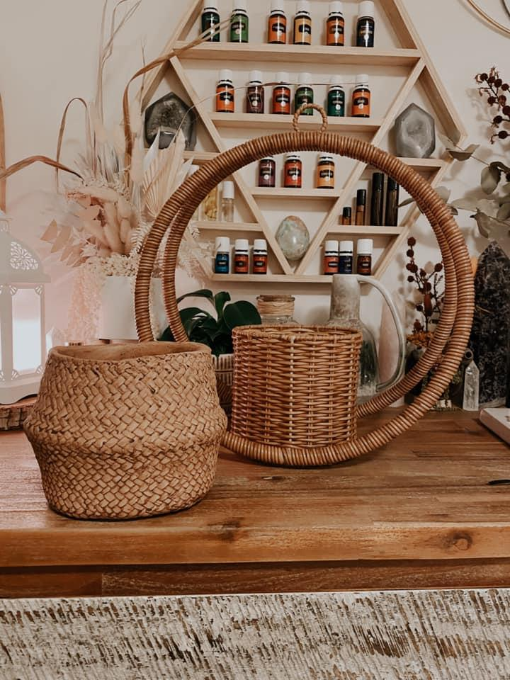 Image of $12 woven plant hanger and $7.50 woven look pot from Kmart in front of oil rack