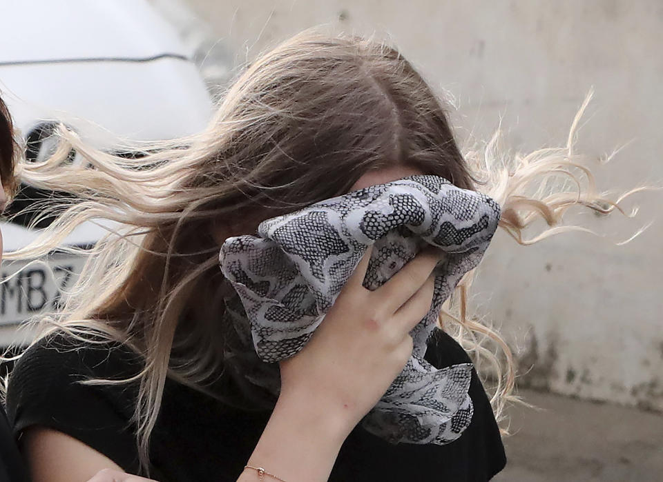 A 19 year-old British woman, that was found guilty of making up claims she was raped by up to 12 Israelis, arrives at Famagusta District Court with her mother for sentencing on Tuesday, Jan. 7, 2020. A Cyprus court handed a four-month suspended sentence to a 19-year-old British woman who was found guilty of public mischief for making up claims that she was raped by up to a dozen Israelis. (AP Photo/Petros Karadjias)