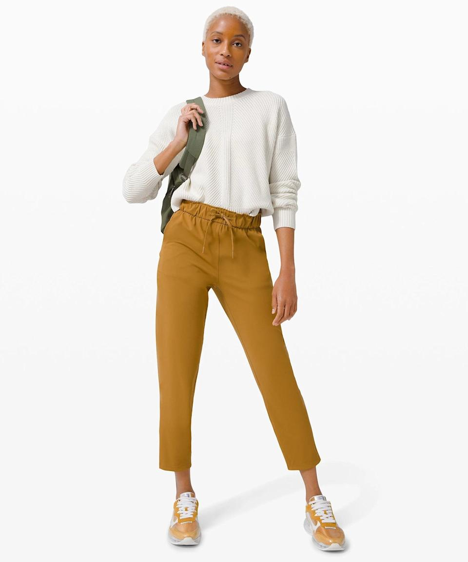 """<h3>Keep Moving Pant 7/8 High-Rise</h3><br>All the comfort of a jogger, with the polished look of a straight-leg trouser. No wonder this hybrid pant is already selling out.<br><br><strong>What They're Saying:</strong> """"Love! They are so comfortable, flattering, and versatile. You can dress down for everyday or dress them up for work (whenever we go back into an office). Definitely would recommend.""""<br><br><strong>lululemon</strong> Keep Moving Pant 7/8 High-Rise, $, available at <a href=""""https://go.skimresources.com/?id=30283X879131&url=https%3A%2F%2Fshop.lululemon.com%2Fp%2Fwomens-trousers%2FKeep-Moving-Pant%2F_%2Fprod9750436"""" rel=""""nofollow noopener"""" target=""""_blank"""" data-ylk=""""slk:lululemon"""" class=""""link rapid-noclick-resp"""">lululemon</a>"""