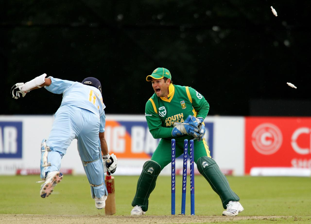 BELFAST, UNITED KINGDOM - JUNE 26:  Mark Boucher of South Africa runs out Sachin Tendulkar of India on 99 during the Future Cup one day international match between India and South Africa at the Civil Service Cricket Ground, Stormont on June 26, 2007 in Belfast, Northern Ireland.  (Photo by Richard Heathcote/Getty Images)