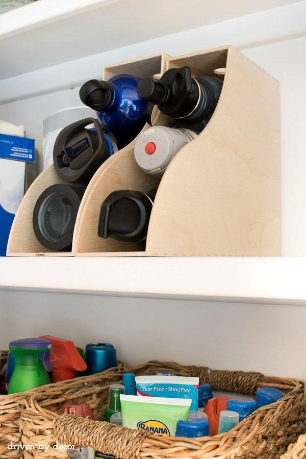 """<p>We've all had that moment when you open up the cabinet and all the reusable water bottles you've ever owned come tumbling that. Say """"enough"""" and become a convert to this new way of storing them: inside a magazine holder.</p><p><a href=""""http://www.drivenbydecor.com/2016/03/kitchen-organization-how-to-organize-ideas.html"""" rel=""""nofollow noopener"""" target=""""_blank"""" data-ylk=""""slk:See more at Driven By Decor »"""" class=""""link rapid-noclick-resp""""><em>See more at Driven By Decor »</em></a></p>"""
