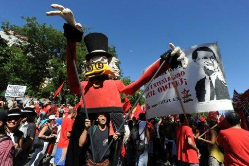 <p>People take part in a demonstration in Madrid on September 15. Mass protests in Spain and Portugal, against ever tougher austerity measures, have ramped up the pressure on Iberian governments struggling to avoid international bailouts</p>